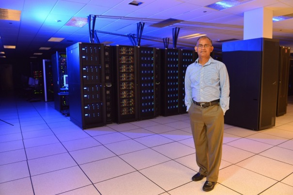 Arun Somani with Cyence, Iowa State University's new high-performance computer, at the Durham Center on campus