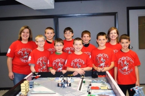 Smiling Robotics Raiders team members and coaches.
