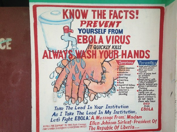 Liberian sign promoting hand-washing as a means to avoid spreading the Ebola virus. It also lists symptoms and precautions.