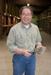 H. Paul Liu with a partial fossil of a eurypterid. Image from the Iowa Geological Survey website.