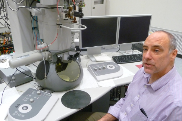 Ames Lab's Matt Kramer with the Tecnai transmission electron microscope at the new Sensitive Instrument Facility (SIF). The Tecnai TEM was moved to the SIF from Wilhelm Hall, one of the buildings the lab occupies on the Iowa State University campus.