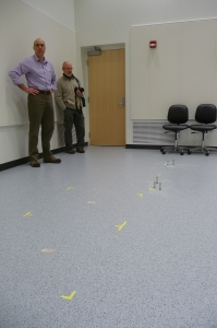 Matt Kramer and Ames Lab science writer Kerry Gibson look over the markings where the aberration-corrected STEM will be installed.