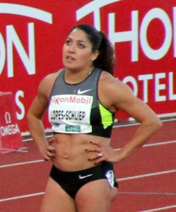 Priscilla Lopes-Schliep at the 2012 Bislett Games. Besides the distinctive muscular upper arms, Betsy Dopf and Jill Viles also noticed the strong muscle definition, somewhat visible here, between Lopes-Schliep's buttock and thigh. It's another characteristic of partial lipodystrophy. Photo by Chell Hill via Wikimedia Commons. Creative Commons license.