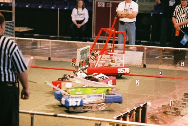 FRC robots mix it up on the playing field at Cedar Falls' McLeod Center.