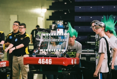 Strange headgear (and safety glasses) are de rigueur at FIRST competitions, as Team ASAP demonstrates. At FRC Iowa Regional in Cedar Falls, Iowa March 24-26, 2016