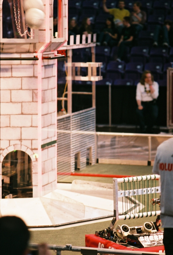 Sherman fires a boulder (upper left) into the blue alliance tower during FRC Iowa Regional competition at the University of Northern Iowa, Cedar Falls.