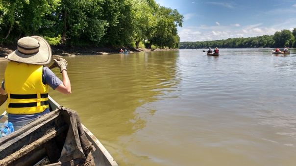 Paula Mohr paddling the lower Des Moines River with other Project AWARE volunteers. The infamous recliner chunk is behind her. Click to enlarge.