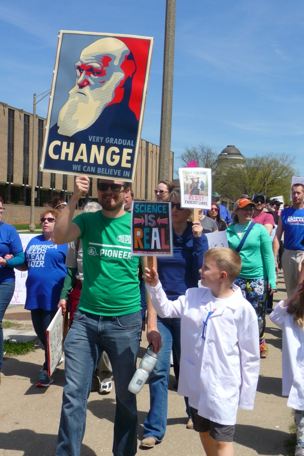 "One of the better signs at last year's March for Science Iowa: A portrait of Darwin with the slogan, ""Very gradual CHANGE we can believe in."". Credit: Paula Mohr."