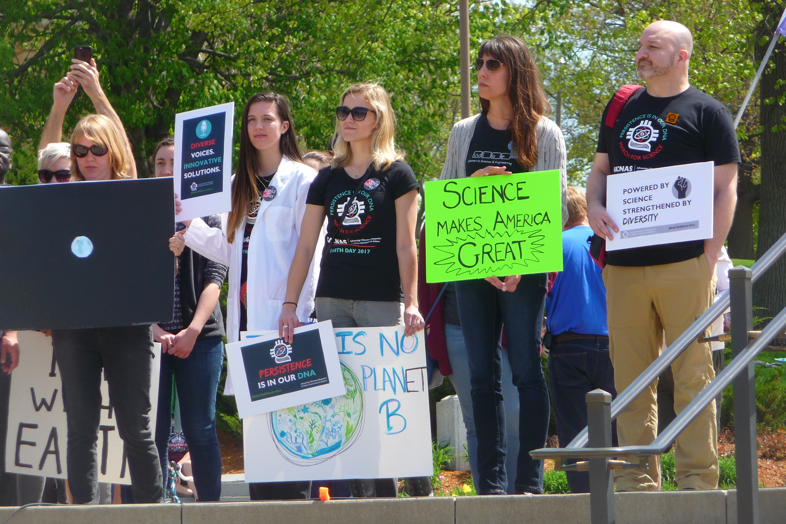 Science backers listen to speakers during the March for Science Iowa on April 22, 2017 at the Iowa State Capitol in Des Moines.
