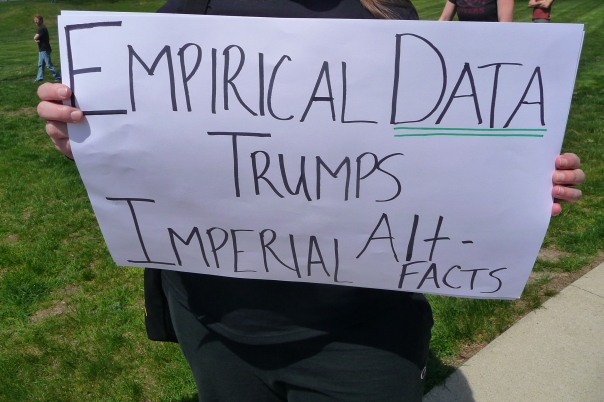 "Woman holds a sign saying ""Empirical Data Trumps Imperial Alt-Facts"" at the 2017 March for Science Iowa."